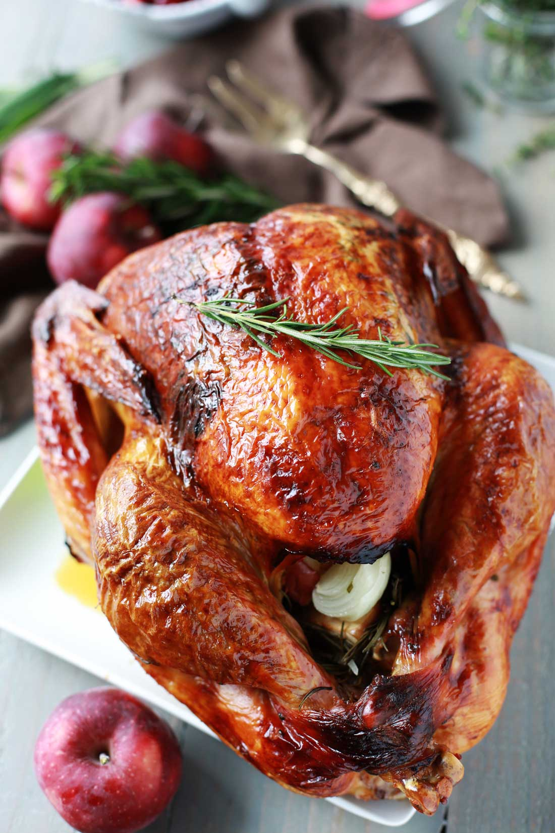 This aromatic lemon, apple and herb turkey is moist, tender, delicious and the perfect centerpiece for your holiday meal! It is easy to make and bursting with flavor.