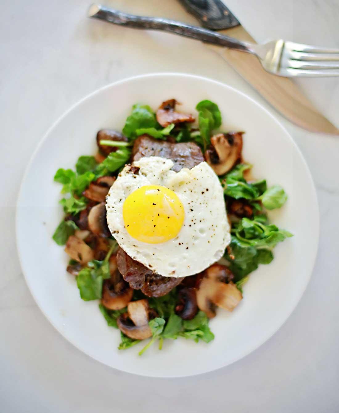 Steak and Eggs on a mushroom watercress salad!