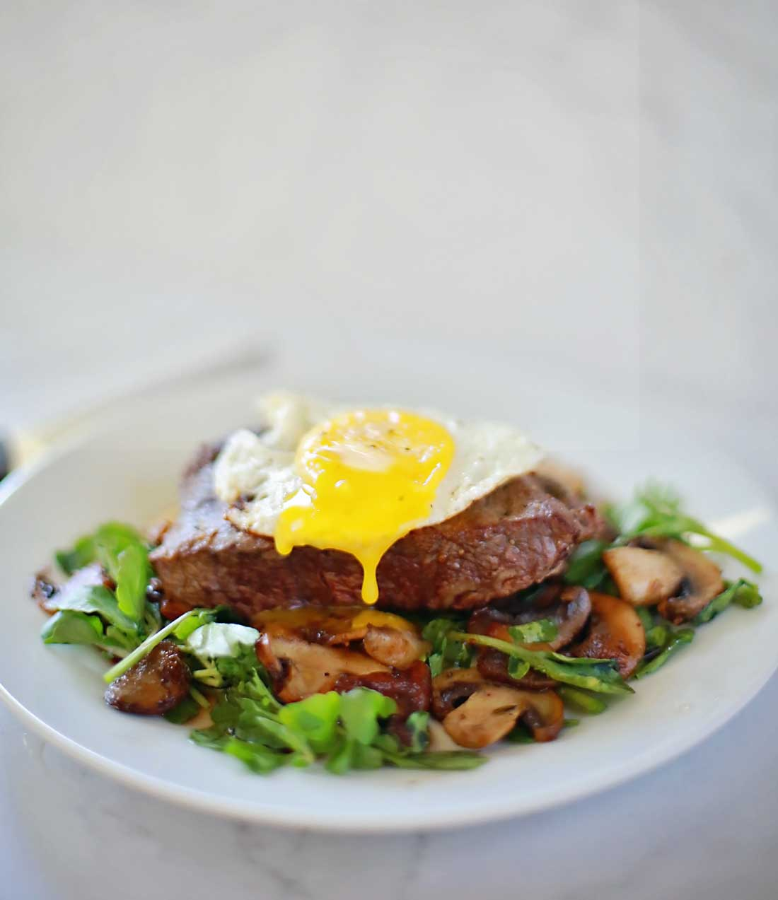 Steak and Eggs with mushrooms on a watercress salad! Sooo good and only takes ten minutes!!!