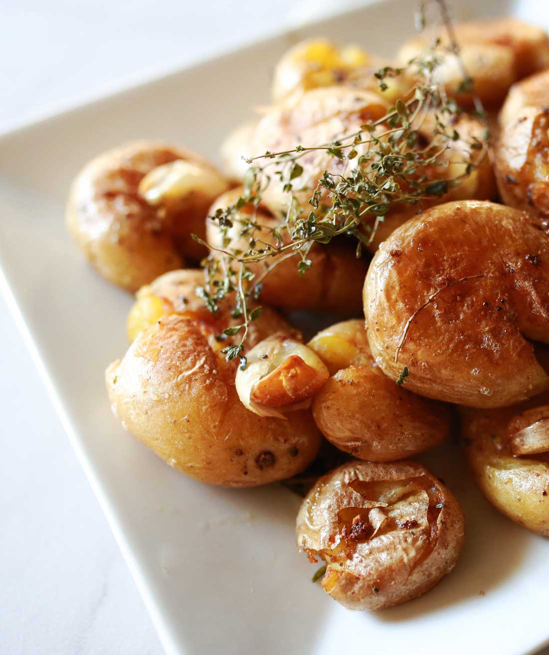 Smashed Potatoes: Marble potatoes tossed with garlic and herbs then roasted until just soft. Slightly smashed with a fork and lightly crisped in hot oil.