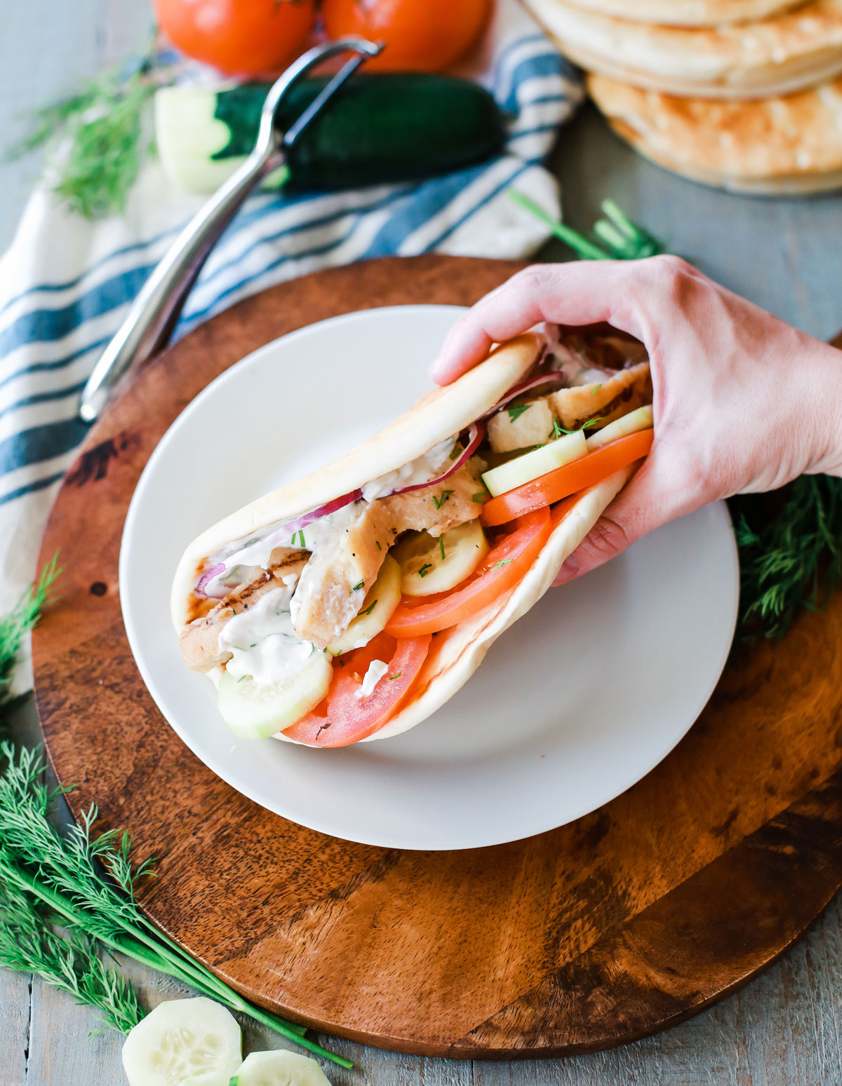 Greek Pita's stuffed with grilled chicken, tomatoes, red onion, cucumber and the best light and refreshing homemade Tzatziki.
