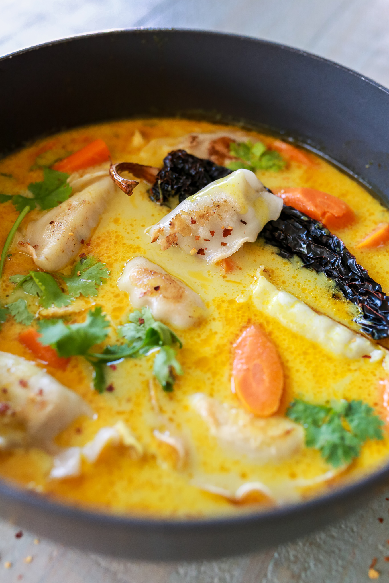 Best ever Coconut curry soup with chicken potstickers!