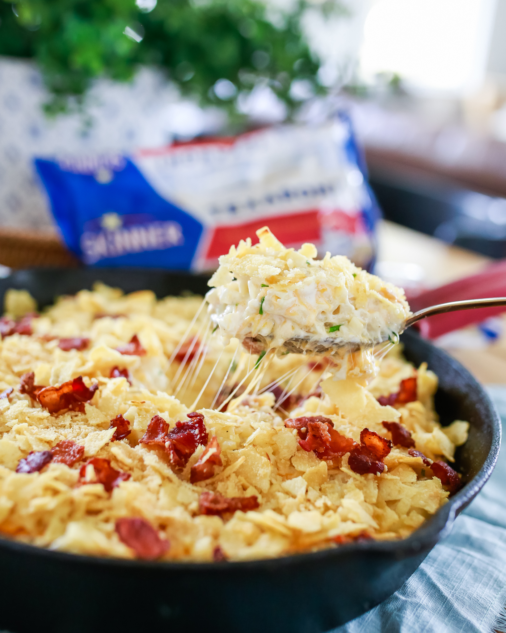 Loaded with cheese, sour cream and bacon, this yummy baked pasta is topped with a potato chip and Parmesan crust.