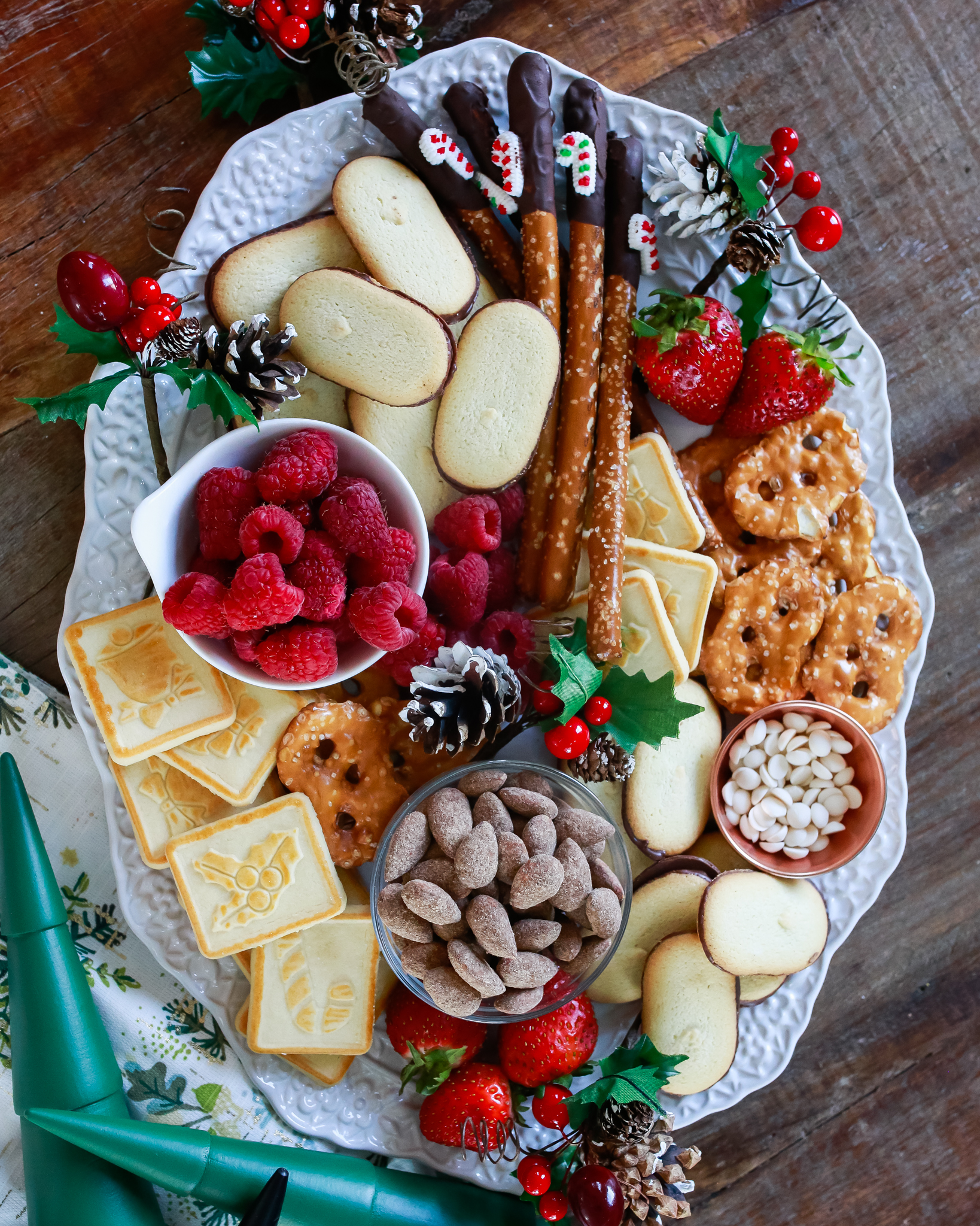 """The ultimate holiday """"charcuterie"""" treat board. All good things combined to make one simple delightful tray of holiday cheer."""